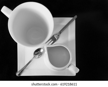 Cup, jug, plate, spoon and fork
