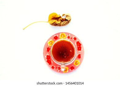 A cup of Kahwa with dry leaf on the white background