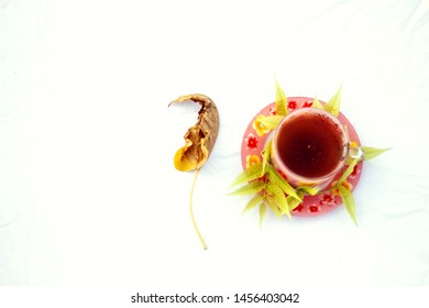 A cup of kahwa with leaf on white background