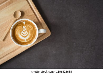 A cup of latte or  cappuccino top view, on wooden plate , image blank space for your text