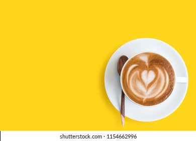A cup of Latte coffee on yellow background. Monday coffee latte.