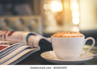 Cup of Latte in coffee shop background, vintage warm tone