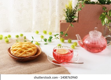 A cup of lemon tea and sweets.