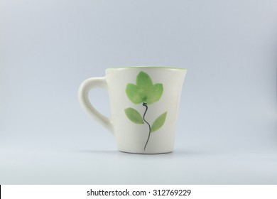cup of little tree with white black ground