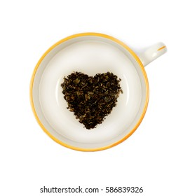 Cup of loose leaf black tea in the shape of a heart.