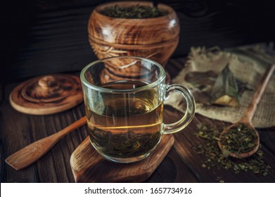 A cup of medicinal soursop tea with dried soursop leaves.
