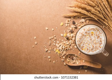 A cup of milk with cereal on wooden table. Healthy breakfast concept. copy space. top view