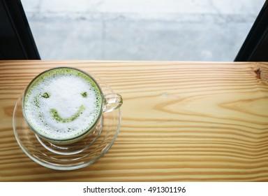 A Cup of  Milk green tea  latte On Woodden Top