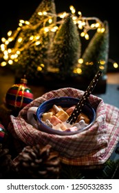 Cup of milk and Marshmallow. Christmas lights and ornaments