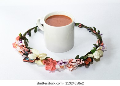 cup of milk tea and floral isolated with white background. image contain grain.