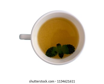 Cup of consommé with mint leaves
