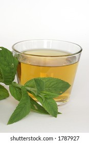 Cup of mint tea with leaves of mint