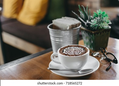 cup of mocha coffee on wooden table in coffee shop