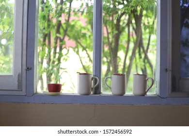 cup and mug on the window of the house