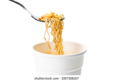 Cup noodle and metal fork isolated on white background with clipping path
