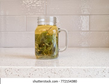 Cup of organic sage tea on a granite counter top
