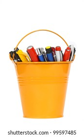 cup with pens on a white background