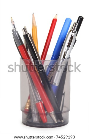 cup with pens and pencils isolated