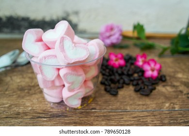 A cup of pink marshmallows.