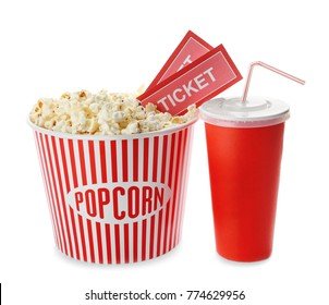 Cup with popcorn, soda and cinema tickets on white background
