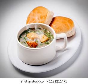 cup of rich and warming soup with clutches