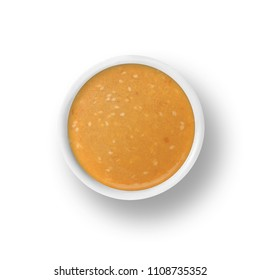 cup of sesame ginger dressing isolated on a white background