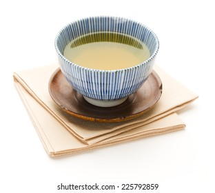 Cup of simmered green tea as a symbol of traditional Japanese hospitality