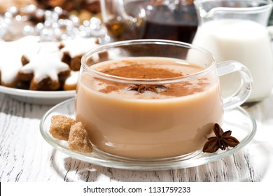 cup of spicy masala tea and Christmas cookies on white background, closeup horizontal
