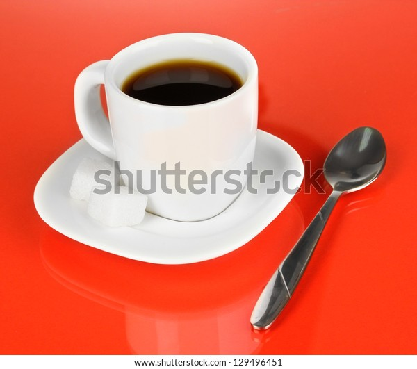 A cup of strong coffee on red background
