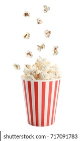 Cup and tasty popcorn on white background