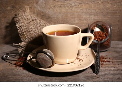Cup of tasty rooibos tea, on wooden table