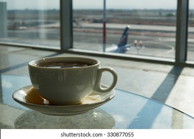 Cup of tea in airport business lounge while waiting for the flight