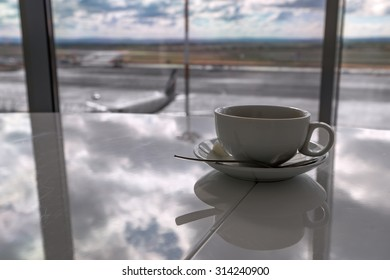 Cup of tea in airport's business lounge. Waiting for the flight