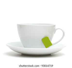Cup of tea with tea bag (blank label) on white background