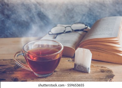 Cup of tea with tea bag  in reading book time