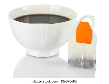 Cup of tea with tea bag solated on white.