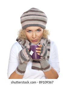 Cup of tea / Beautiful blond woman in a winter clothes drinking tea
