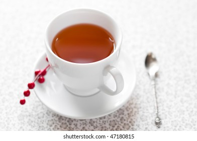 Cup of tea with berries background
