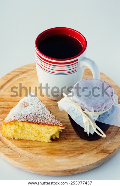 A cup of tea with cake