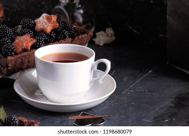 Cup of Tea and Cake. Dark background.