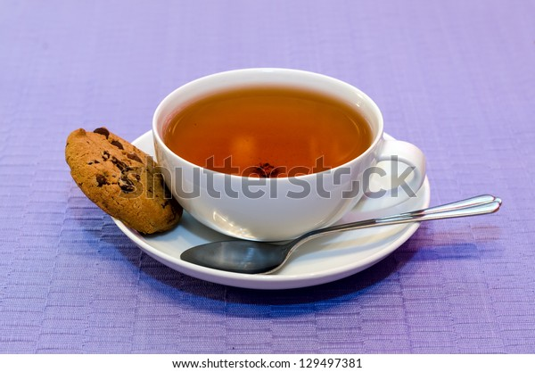 Cup of tea with cookies.