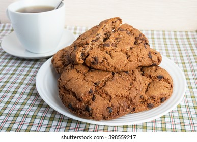 """Cup of tea and cookies with chocolate """"Americano"""" on a light background"""