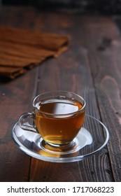 A cup of tea in dark mood selective focus