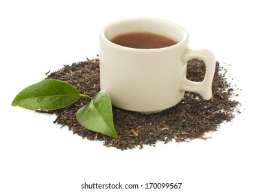 a cup of tea and dry tea leaves