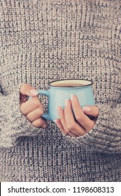 a cup of tea in female hands