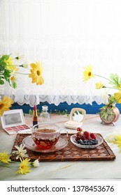 A cup of tea and fresh fruits.