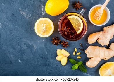 cup of tea with ginger, lemon, honey, anise, cloves, cardamom and mint