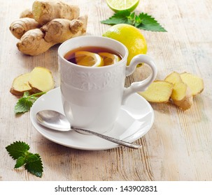 Cup of tea  and ginger. Selective focus