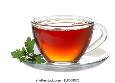 Cup tea and green leaf on white