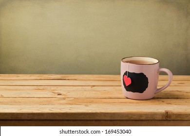 Cup of tea with heart shape. Valentine's day background